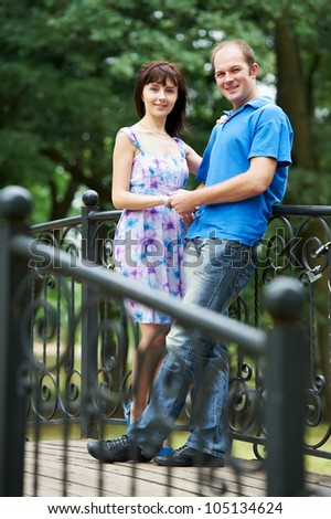 Portrait of Young man and girlfriend on a date engagement outdoors in park