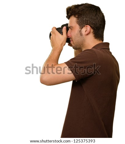 Portrait Of Young Man Capturing Photo On White Background