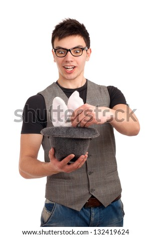 Portrait of young man doing magic - stock photo
