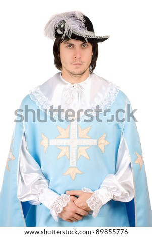 Portrait of young man dressed as musketeer - stock photo
