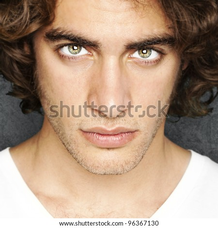portrait of young man face against a vintage wall - stock photo