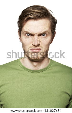 Portrait of young man. Facial expression. Funny face. - stock photo