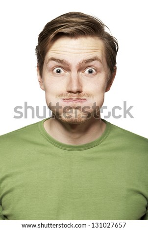 Portrait of young man. Facial expression. Funny face.