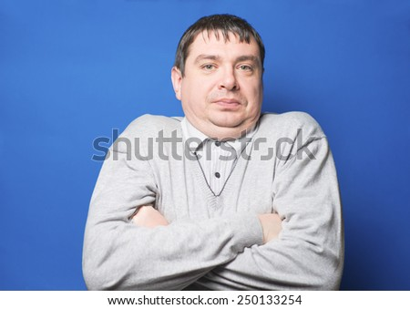 Portrait of young man . Handsome young  male model standing with his arms crossed looking at camera. - stock photo