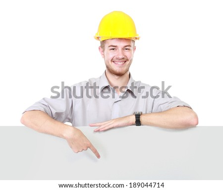 portrait of Young man holding blank billboard - stock photo