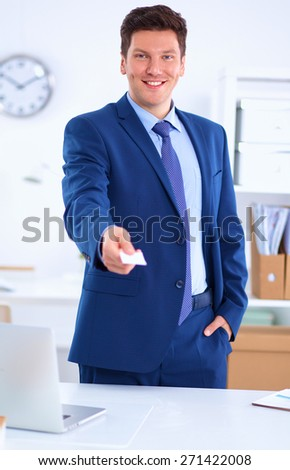 Portrait of young man holding blank white card . - stock photo