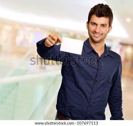 Portrait Of Young Man Holding Blank White Card, Indoor
