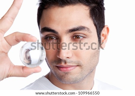 Portrait of young man holding crystal ball isolated on white background. - stock photo