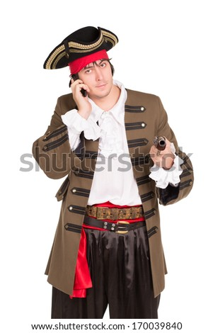 Portrait of young man in pirate costume talking on the phone. Isolated - stock photo