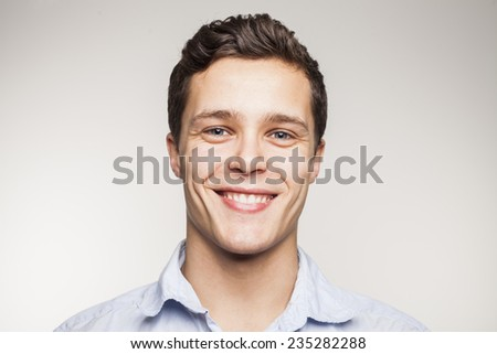 Portrait of young man in studio setting - stock photo