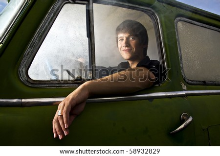 portrait of young man in the car full of smoke - stock photo