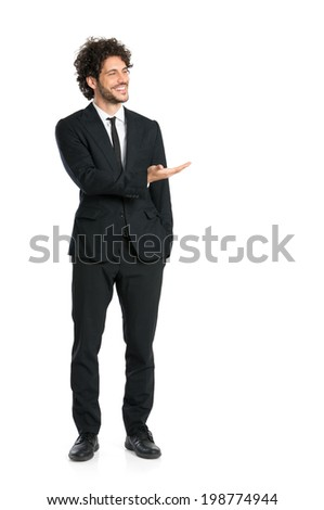 Portrait Of Young Man In Tuxedo Giving Presentation Isolated On White Background - stock photo