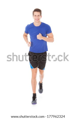 Portrait Of Young Man Jogging On White Background - stock photo