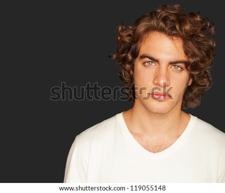 Portrait Of Young Man On Black Background - stock photo