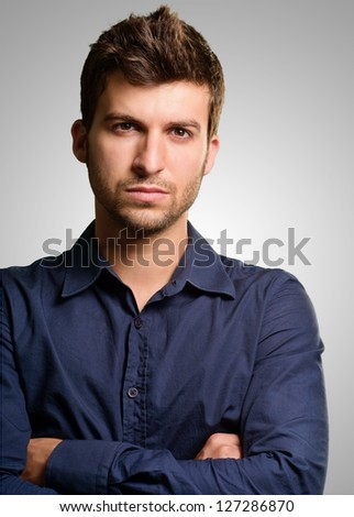 Portrait Of Young Man On Grey Background - stock photo
