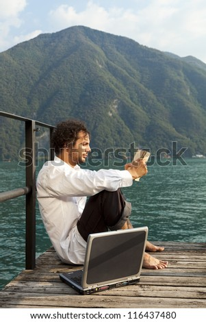 portrait of young man on the dock of Lake