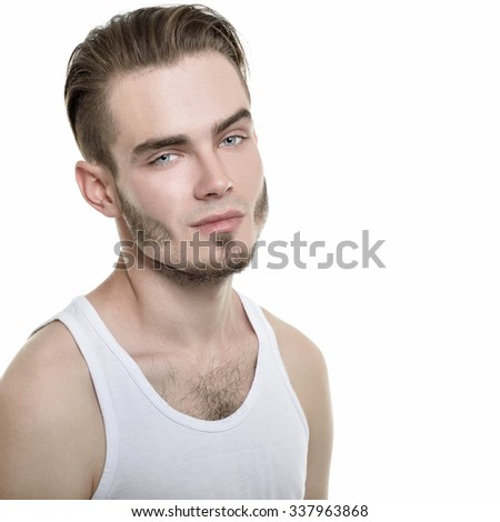 Portrait of young man over white background, image toned. - stock photo