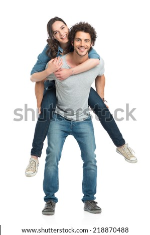 Portrait Of Young Man Piggybacking Her Girlfriend Isolated On White Background - stock photo