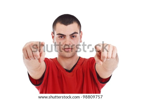 Portrait of young man pointing at you over white background