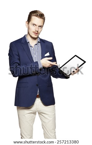 Portrait of young man pointing something on digital tablet. - stock photo