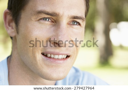 Portrait Of Young Man Relaxing In Park