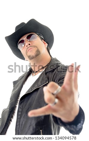 Portrait of young man showing you rock sign on white background - stock photo