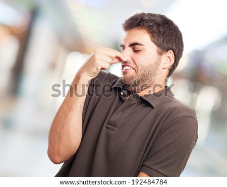portrait of young man smelling closeup photo - stock photo