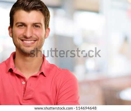 Portrait of young man smiling, background - stock photo