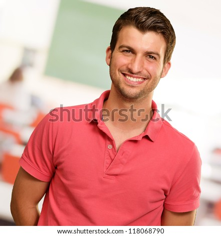 Portrait of young man smiling, indoor - stock photo