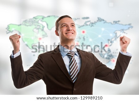 Portrait of young man standing in front of big world map. Server locations and actual online connections are displayed on virtual map. Hosting provider concept. - stock photo