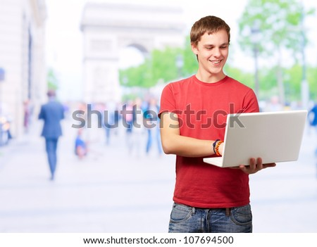 Portrait Of Young Man Using Laptop, Outdoor