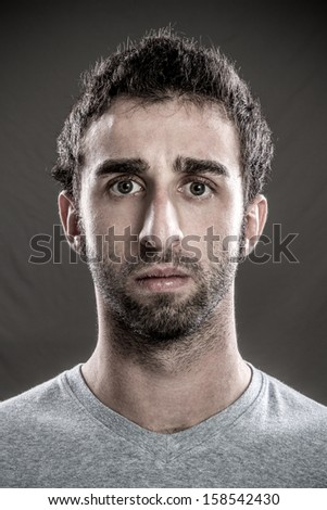 Portrait of young man vexed - stock photo