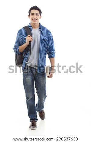 Portrait of young man walking with bag and book over white background - stock photo