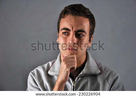 portrait of young man with a face of concern - stock photo