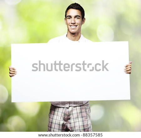 portrait of young man with banner against a plants background