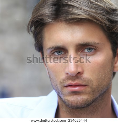 portrait of young man with blue eyes - stock photo