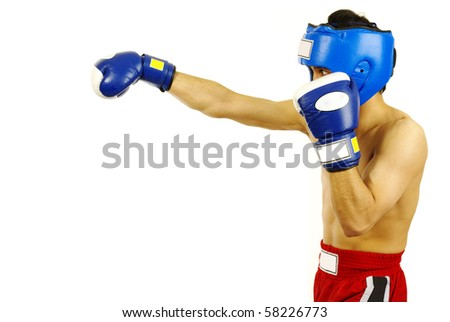 Portrait of young man with boxing helmet and gloves over white background - stock photo