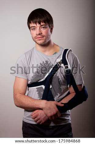 Portrait of young man with broken hand