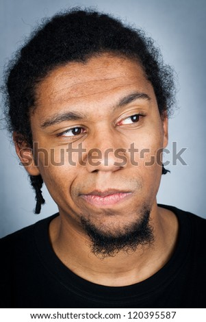 Portrait of young man with emotional facial expression - wondering man