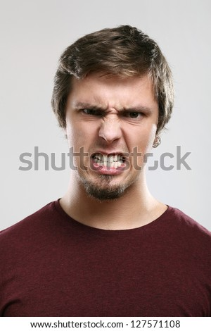 Portrait of young man with expression  isolated over background - stock photo