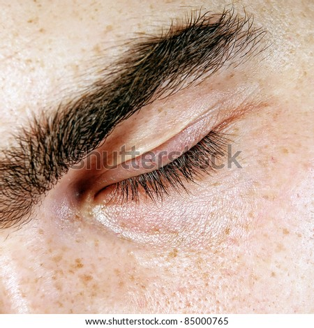 Portrait of young man with eyes closed - stock photo