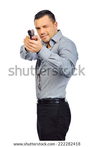 Portrait of young man with gun on white background