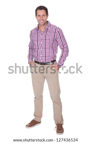 Portrait Of Young Man With Hand In Pocket Isolated On White Background