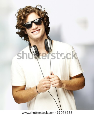 portrait of young man with headphones indoor - stock photo