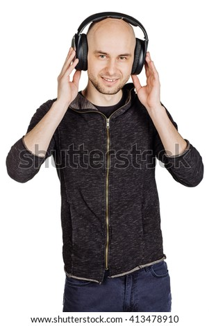 portrait of young man with headphones listening music and dancing . image isolated white background