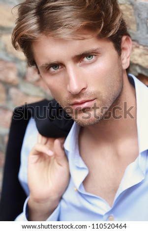 portrait of young man with impressing blue eyes - stock photo