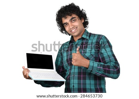 portrait of Young man with laptop showing thumb up isolated white background - stock photo