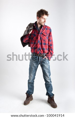 Portrait of young man with plaid shirt and leather jacket. - stock photo