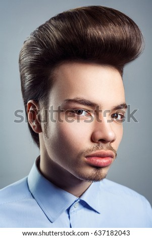 Pompadour stock images royalty free images vectors shutterstock portrait of young man with retro classic pompadour hairstyle studio shot looking at camera urmus Image collections