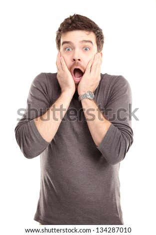 Portrait of young man with shocked facial expression, isolated over white background - stock photo
